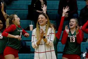 The Woodlands head coach Terri Wade reacts along with the rest of the bench after a play by setter Clara Brower during the second set of a Region II-6A area high school volleyball playoff match at Brenham High School, Thursday, Nov. 7, 2019, in Brenham.