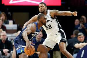 Minnesota Timberwolves' Noah Vonleh, left, drives past San Antonio Spurs' Rudy Gay in the first half of an NBA basketball game Wednesday, Nov 13, 2019, in Minneapolis. (AP Photo/Jim Mone)