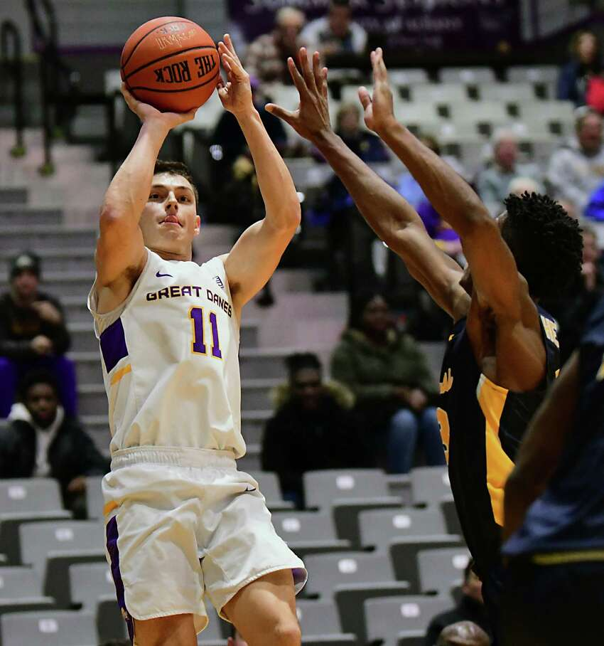 University at Albany's Cameron Healy puts up a three pointer during a basketball game against Canisius at the SEFCU Arena on Wednesday, Nov. 13, 2019 in Albany, N.Y. (Lori Van Buren/Times Union)