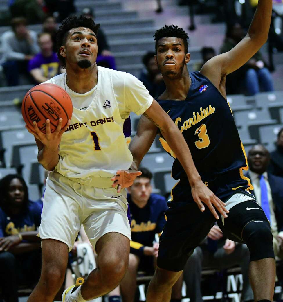 University at Albany's Malachi De Sousa drives to the hoop guarded by Canisius' Jordan Henderson during a basketball game at the SEFCU Arena on Wednesday, Nov. 13, 2019 in Albany, N.Y. (Lori Van Buren/Times Union)