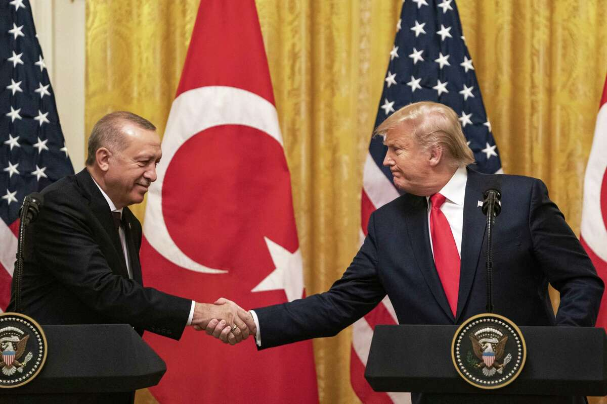 U.S. President Donald Trump shakes hands with Recep Tayyip Erdogan, Turkey's president, left, during a joint press conference at the White House in Washington, D.C., U.S. on Wednesday, Nov. 13, 2019. TrumpA said he'll discuss a trade deal with ErdoganA during a White House meeting on Wednesday. Photographer: Alex Edelman/Bloomberg
