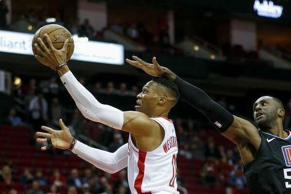 Houston Rockets guard Russell Westbrook (0) shoots a layup against LA Clippers forward Patrick Patterson (54) during the first quarter of an NBA game at the Toyota Center Wednesday, Nov. 13, 2019, in Houston.
