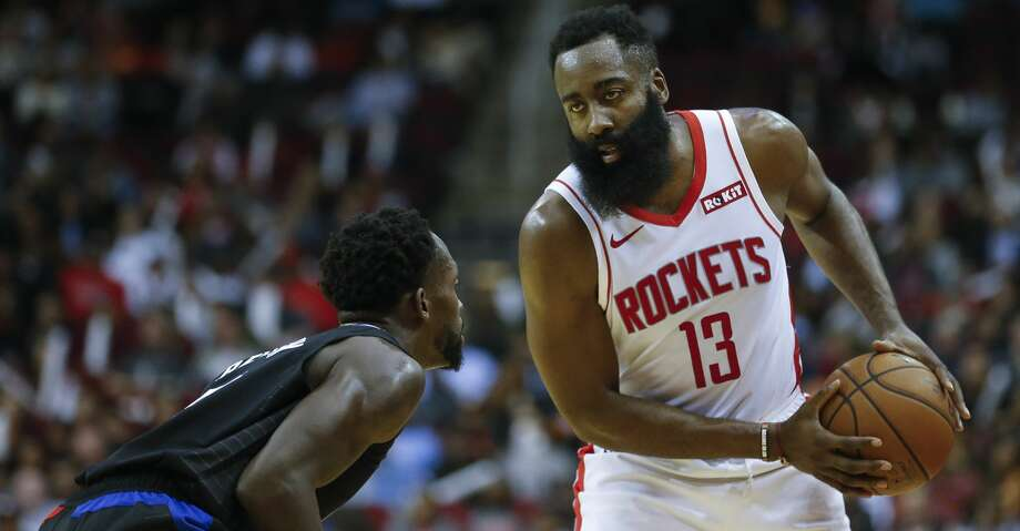 Houston Rockets guard James Harden (13) looks for an open teammate while defended by LA Clippers guard Patrick Beverley (21) during the first half of an NBA game at the Toyota Center Wednesday, Nov. 13, 2019, in Houston. Photo: Godofredo A Vásquez/Staff Photographer