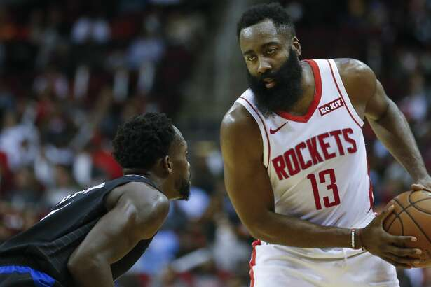 Houston Rockets guard James Harden (13) looks for an open teammate while defended by LA Clippers guard Patrick Beverley (21) during the first half of an NBA game at the Toyota Center Wednesday, Nov. 13, 2019, in Houston.