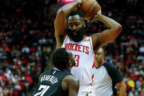 Rockets guard James Harden plots his options while defended by the Clippers' Patrick Beverley at Toyota Center on Wednesday night.