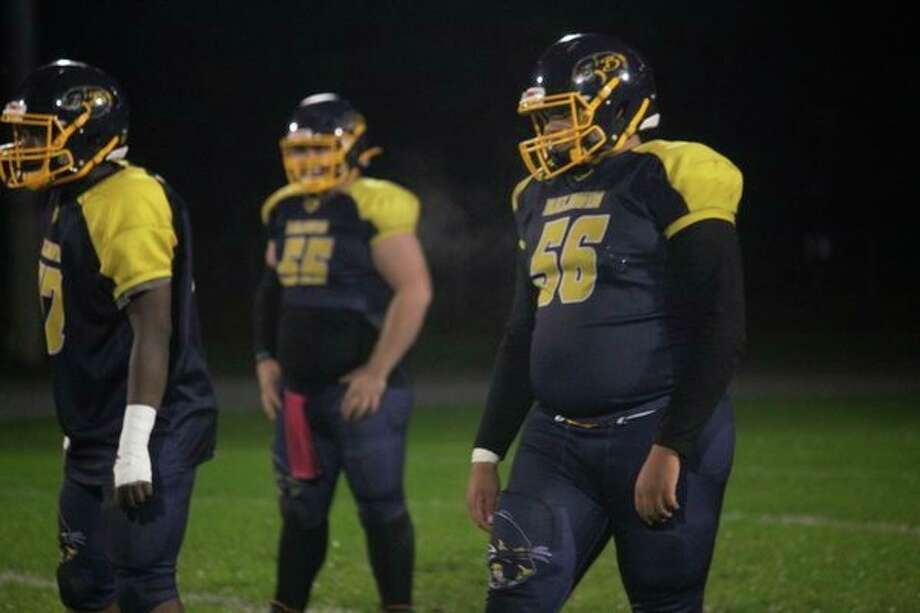 Darrion Hayter (56) was among the West Michigan D League's top linemen this season. (Star file photo)