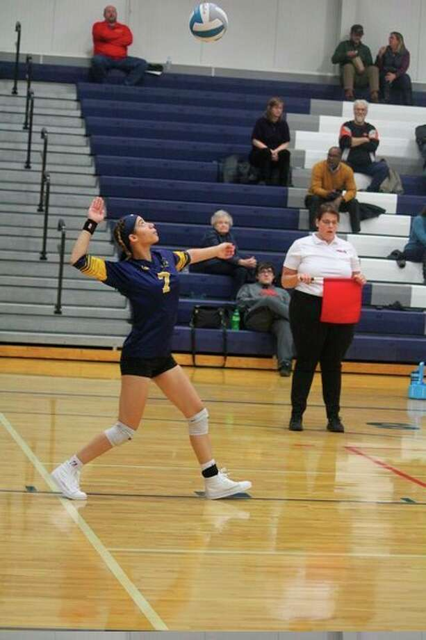 Baldwin's Monique Rowland gets set to serve he ball against Crossroads last week. (Star photo/John Raffel)