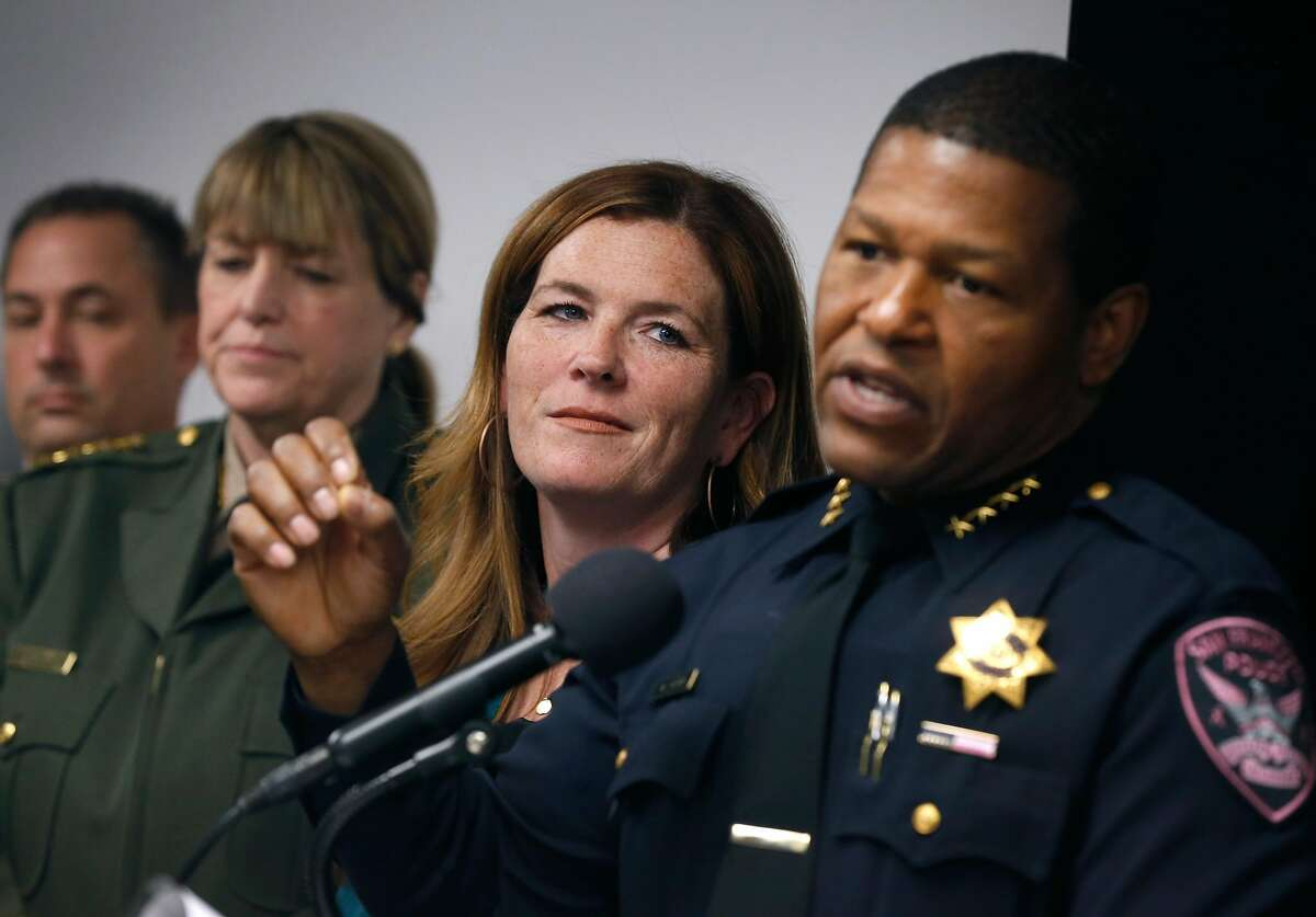 Interim District Attorney Suzy Loftus listens to Police Chief Bill Scott speak at a news conference after Loftus announces the formation of a multi-agency strike force dedicated to combating auto burglaries in San Francisco, Calif. on Thursday, Oct. 31, 2019. Appointed to the interim position by Mayor London Breed, Loftus made the announcement in the days leading up to the election in her race to become the permanent D.A.