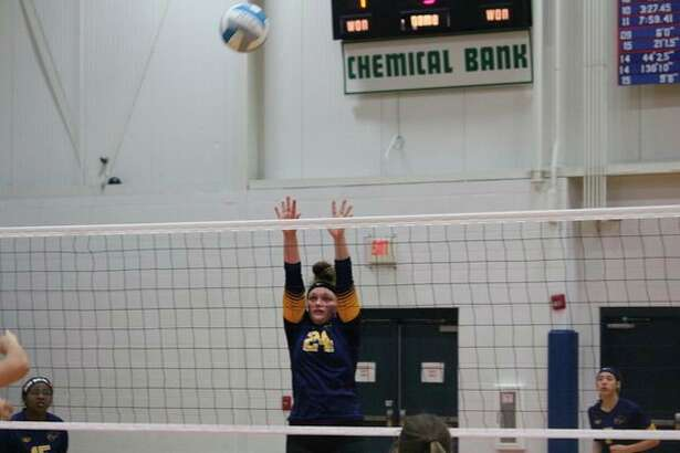 Baldwin's Abby Oisten goes up for the ball in last week's district semifinal match at Baldwin. (Star photo/John Raffel)