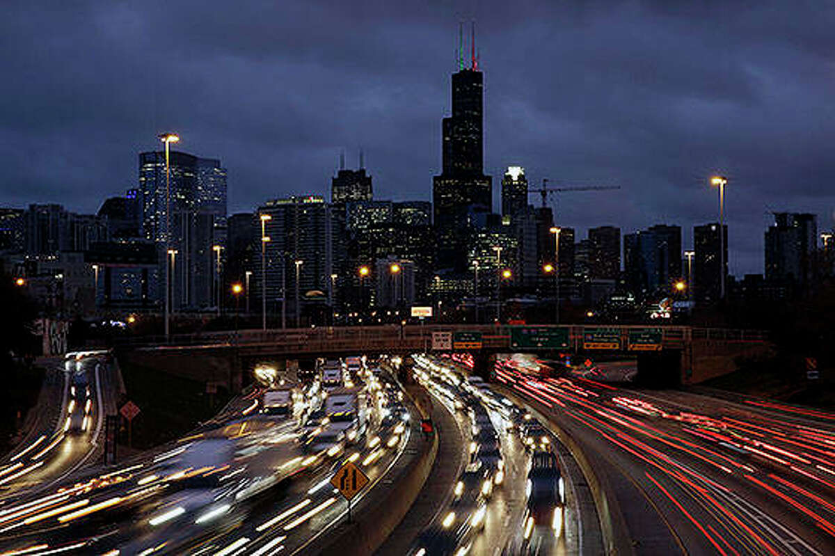 Traffic streaks across the John F. Kennedy Expressway at the start of the Thanksgiving holiday weekend last year in Chicago. The Transportation Security Administration said Wednesday that it expects to screen more than 26.8 million passengers from Nov. 22 through Dec. 2, a 4% increase over last year.