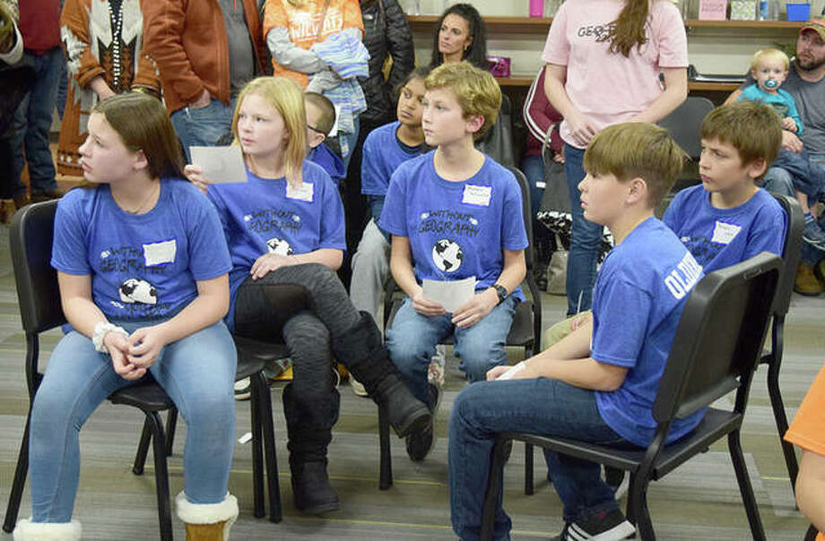 South Jacksonville Elementary students Olivia Dobson, Kamryn Rowland, Andrew Schumacher, Kaleab West and Kellon Oldenettel try to come up with the answer to a question at the 2019 Regional Geography Bowl on Wednesday. South Jacksonville took second place in the competition where students from schools competed to answer geography-based questions. Eisenhower Elementary School took first place. Photo: Marco Cartolano | Journal-Courier