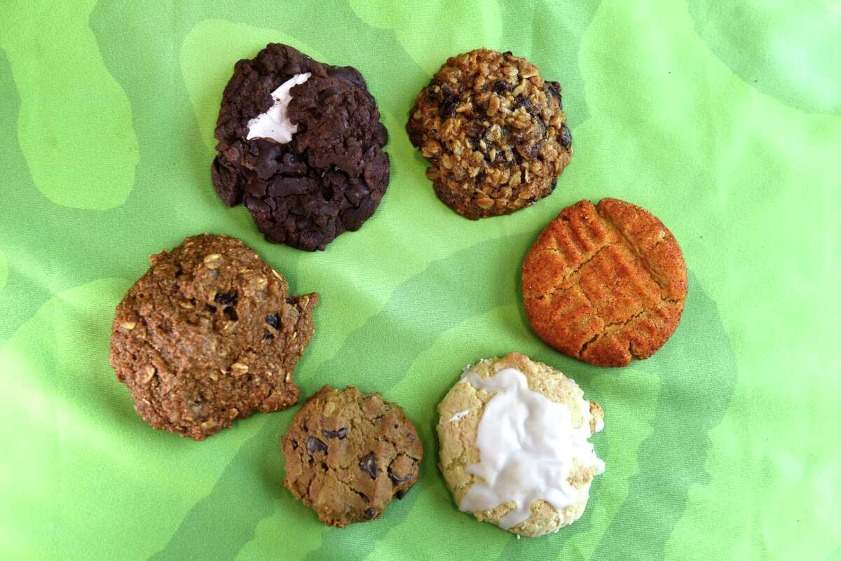 From upper left, clockwise; Black velvet mint surprise cookies, by Andrea Shaye, Gingered chocolate, Masala chai oatmeal cookies, by Felicia A. Reid, Peanut butter paprika cookies, by Deb Smith, Zingy lemon cookies, by Megan Brophy-McLean, Vegan chickpea chocolate chip cookies, by Lisa Maffucci, and Healthy applesauce oatmeal big cookies, by Mary Ellen Chardavoyne on Monday, Nov. 11, 2019, at Honest Weight Food Co-op in Albany, N.Y. (Will Waldron/Times Union)