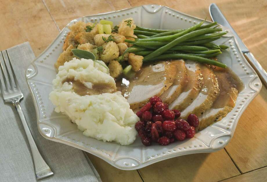 Several area restaurants are serving holiday-themed Thanksgiving dinners around Nov. 28. (Getty Images) Photo: Tetra Images / Tetra images RF