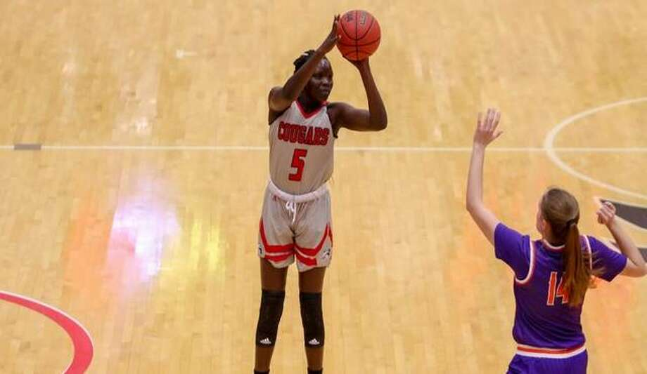 SIUE guard Ajulu Thatha puts up a shot over an Evansville defender. Photo: SIUE