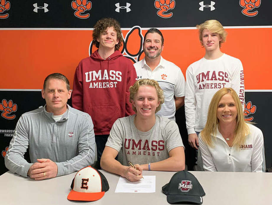 Edwardsville senior Will Range, seated center, signed a letter of intent to play baseball for the University of Massachusetts. He is joined by his parents, brothers and EHS coach Tim Funkhouser. Photo: Matt Kamp|The Intelligencer