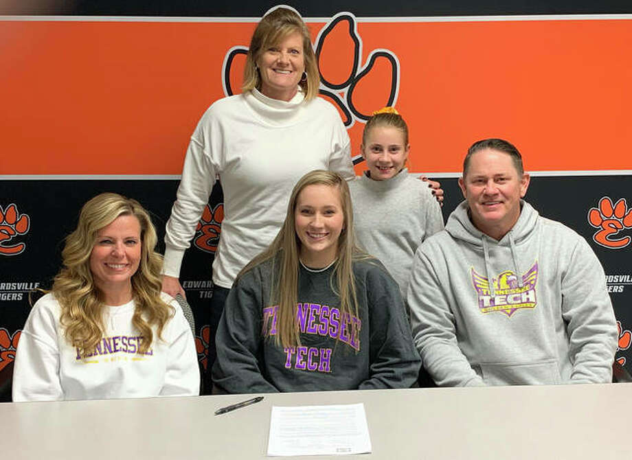 Edwardsville senior Maddie Isringhausen, seated center, will play volleyball at Tennessee Tech next season. Isringhausen is joined by her parents, sister and EHS coach Lisa Orlet. Photo: Matt Kamp|The Intelligencer