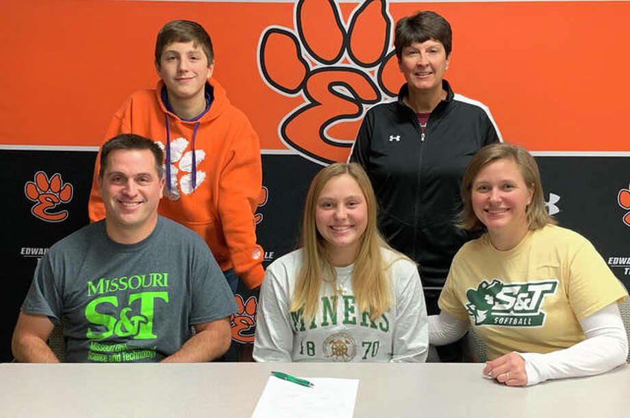 Edwardsville senior Ellie Viox, seated center, will play softball for Missouri S&T. She is joined by her parents, brother and EHS coach Lori Blade. Photo: Matt Kamp|The Intelligencer