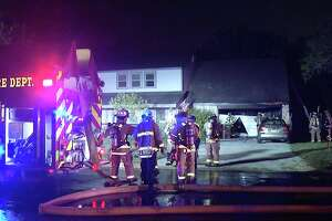 Two dogs helped a family get out safely after a fire started in a Northwest Side home.