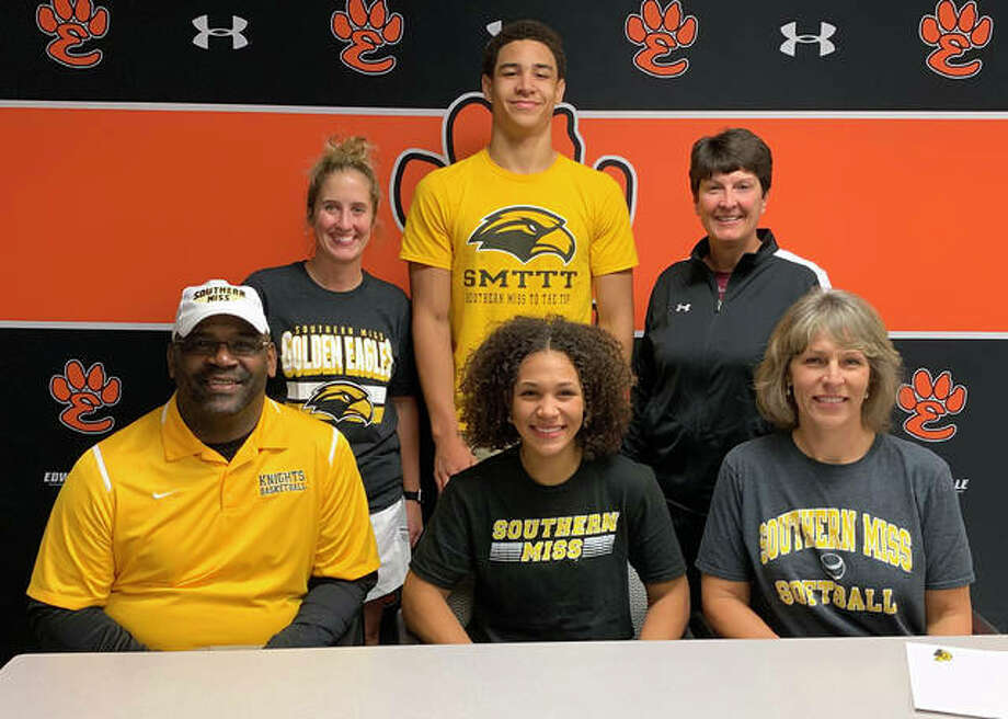 Edwardsville senior Maria Smith, seated center, will play softball for Southern Miss. She is joined by her parents, brother, EHS coach Lori Blade, standing right, and EHS assistant coach Caty Ponce, standing left. Photo: Matt Kamp|The Intelligencer