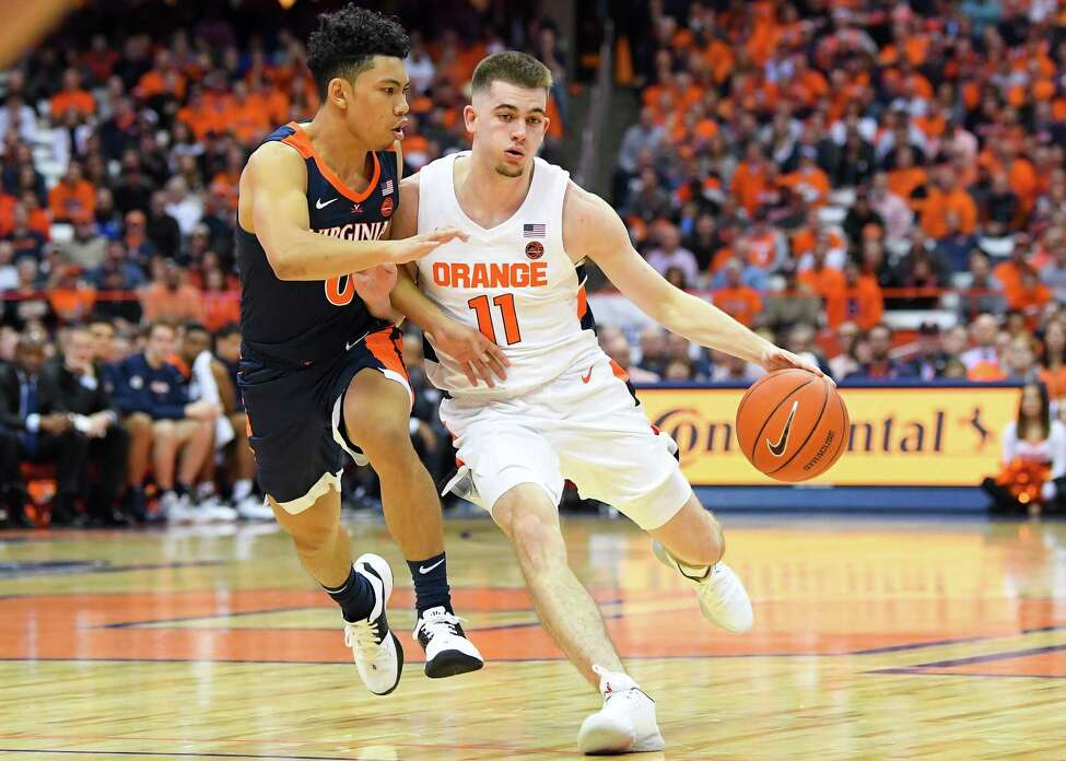 SYRACUSE, NY - NOVEMBER 06: Joe Girard III #11 of the Syracuse Orange drives to the basket against the defense of Kihei Clark #0 of the Virginia Cavaliers during the second half at the Carrier Dome on November 6, 2019 in Syracuse, New York. Virginia defeated Syracuse 48-34.