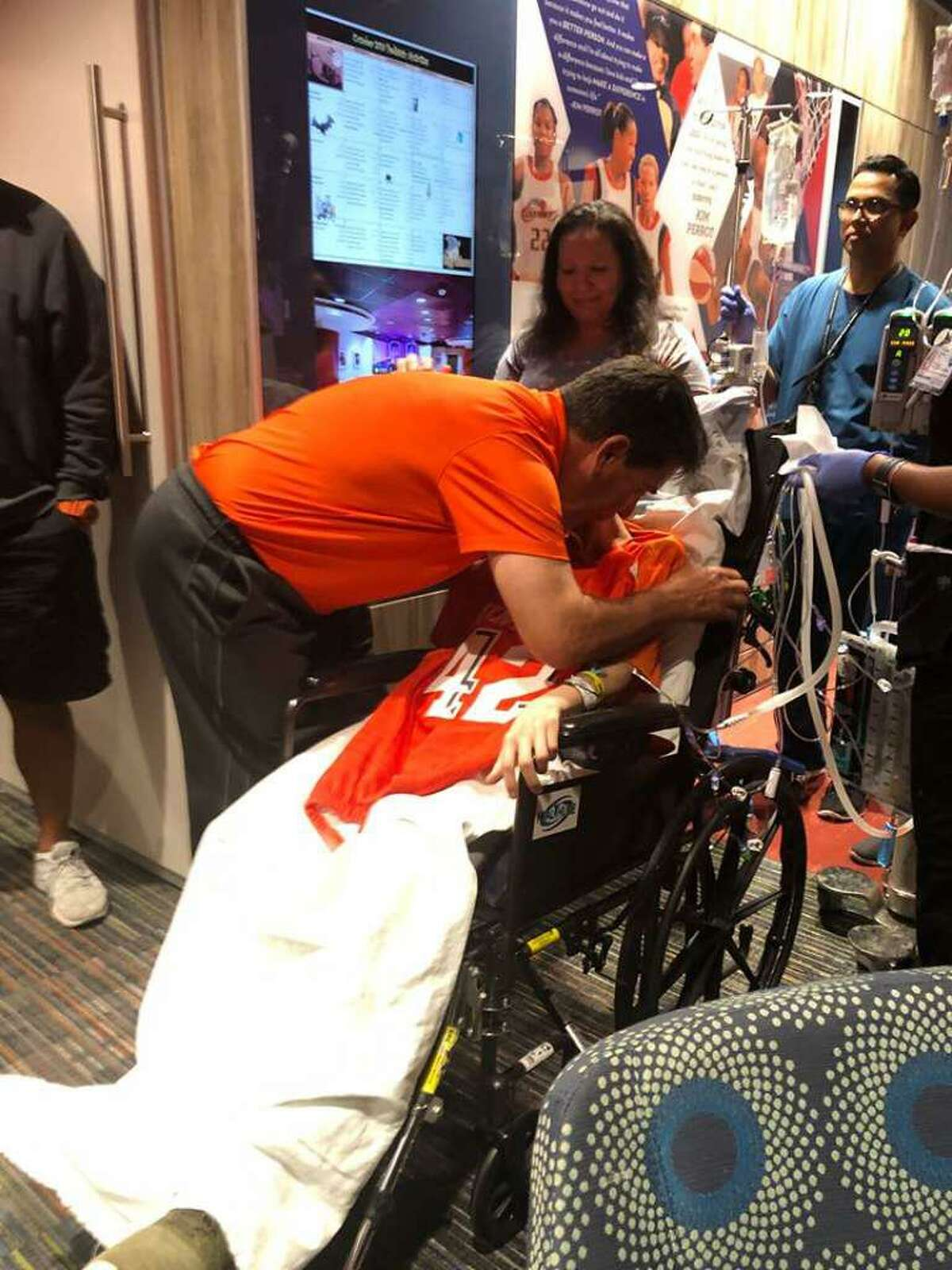 United football head coach David Sanchez presented Jalen Garcia with his orange No. 42 jersey on Oct. 7.