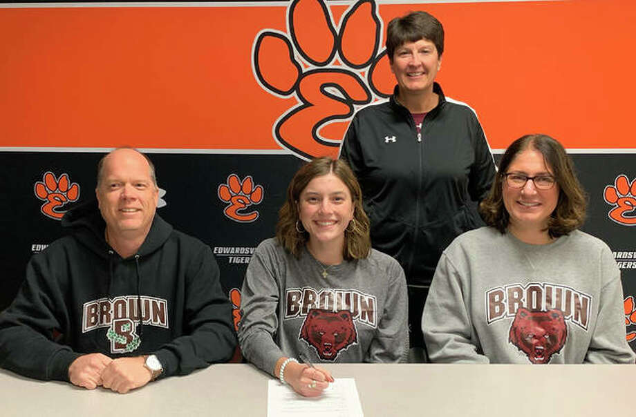 Edwardsville senior Moe Kastens, seated center, will play softball for Brown University. Kastens is joined by her parents and EHS coach Lori Blade. Photo: Matt Kamp|The Intelligencer