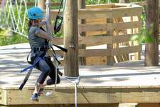 The Woodlands newest recreational amenity -Texas TreeVentures high-ropes course -has been open six months. Chris Nunes, the director of the Parks and Recreation Department of The Woodlands Township, said the course, which opened in April, will soon surpass 5,500 paid users. In this archive photograph, former Villager reporter Jane Stueckemann swings from a rope on Tuesday, April 9, 2019 at Texas TreeVentures in The Woodlands.