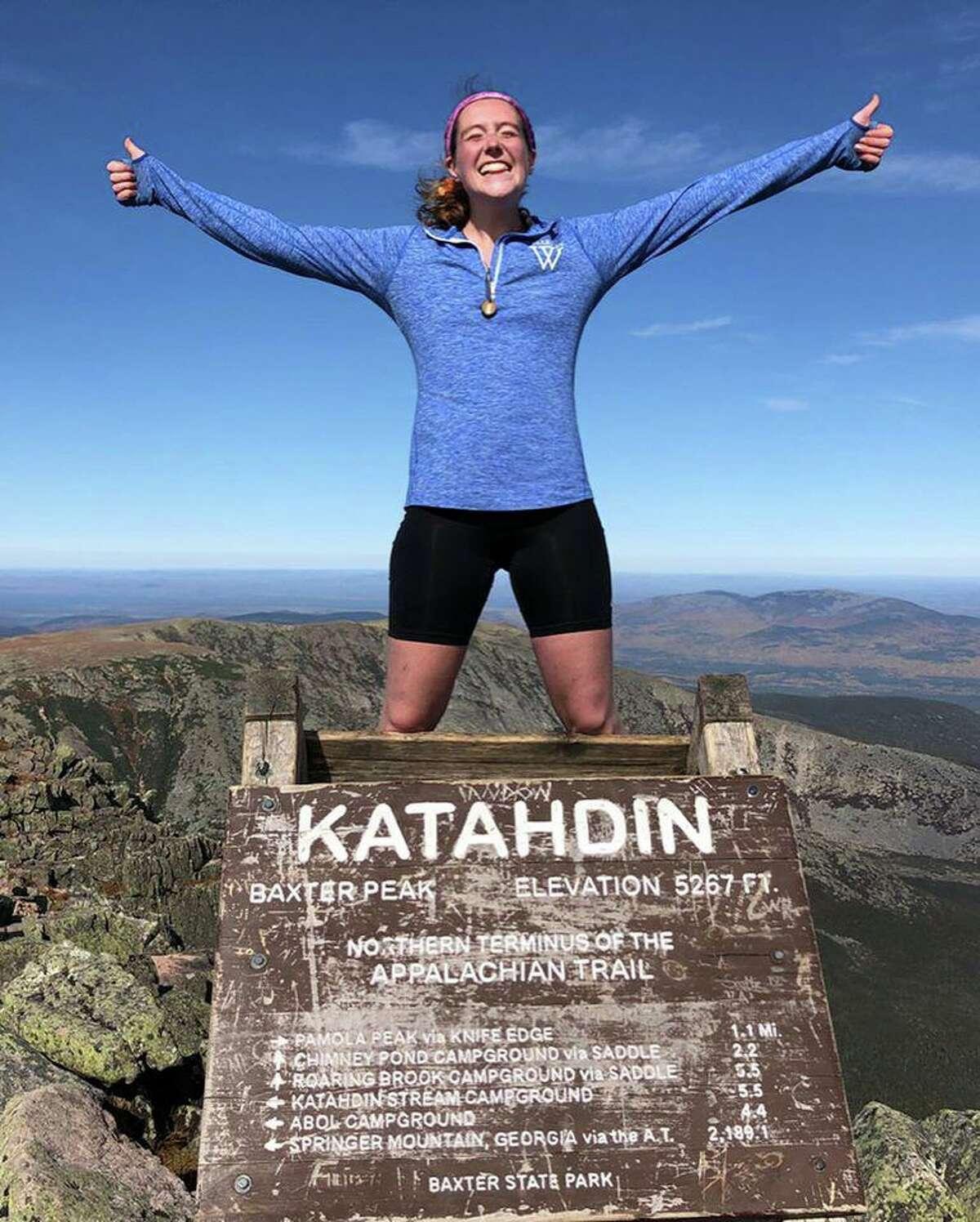 Diana Jackson, 23, of Darien, finishes her Appalachian Trail adventure on the peak of Mt Katahdin.