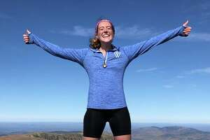 Diana Jackson, 23, of Darien, finishes her Appalachian Trail adventure on the peak of Mt Katahdin.