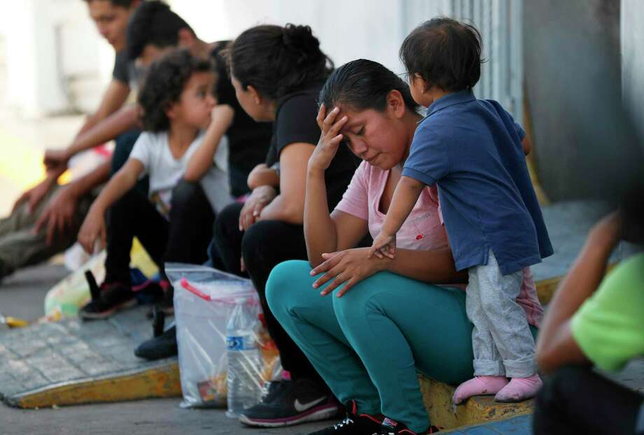 "Migrants this summer wait at an immigration center in Nuevo Laredo, Mexico. The Trump administration's ""Remain in Mexico"" program has forced migrants into dangerous conditions and undermines due process. Photo: Marco Ugarte /Associated Press / Copyright 2019 The Associated Press. All rights reserved."