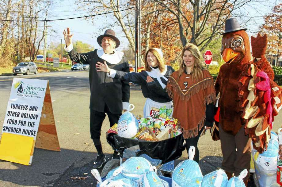 Dr. Bruce Sofferman, owner of Smile Dental Center, his wife, Deborah, and daughter Sophia, along with quite an enthusiastic turkey will be holding their 32nd annual Thanksgiving food drive on Wednesday, Nov. 20, from 10 a.m. to 2 p.m. outside his office's location at 1000 Bridgeport Avenue. Photo: Contributed Photo / / Connecticut Post