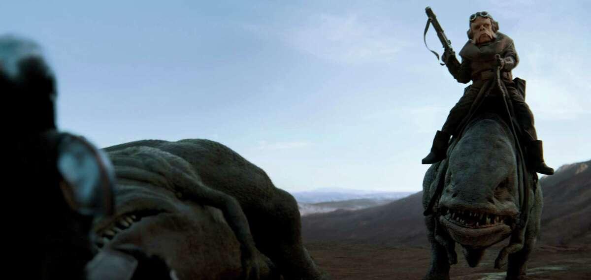 The Mandalorian (Pedro Pascal) and the Ugnaught Kuiil.