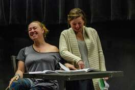 """Chaney Moore, left, and Joanna Hubbard rehearse for Pasadena Little Theatre's production of the drama """"Proof."""" The actresses portray sisters in the play, in which a family deals with mental illness and the nature of genius."""