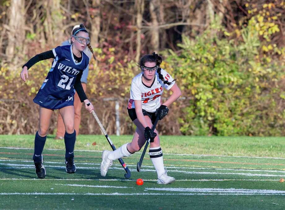 Cate Irving and the Ridgefield field hockey team advanced to the state quarterfinals with a 2-0 win over Wilton on Wednesday. Photo: Gretchen McMahon / For Hearst Connecticut Media