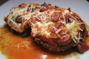 Melanzane Ana Maria is breaded eggplant with mozzarella, prosciutto and sun-dried tomato in roasted red pepper sauce at Gennaro's Trattoria.