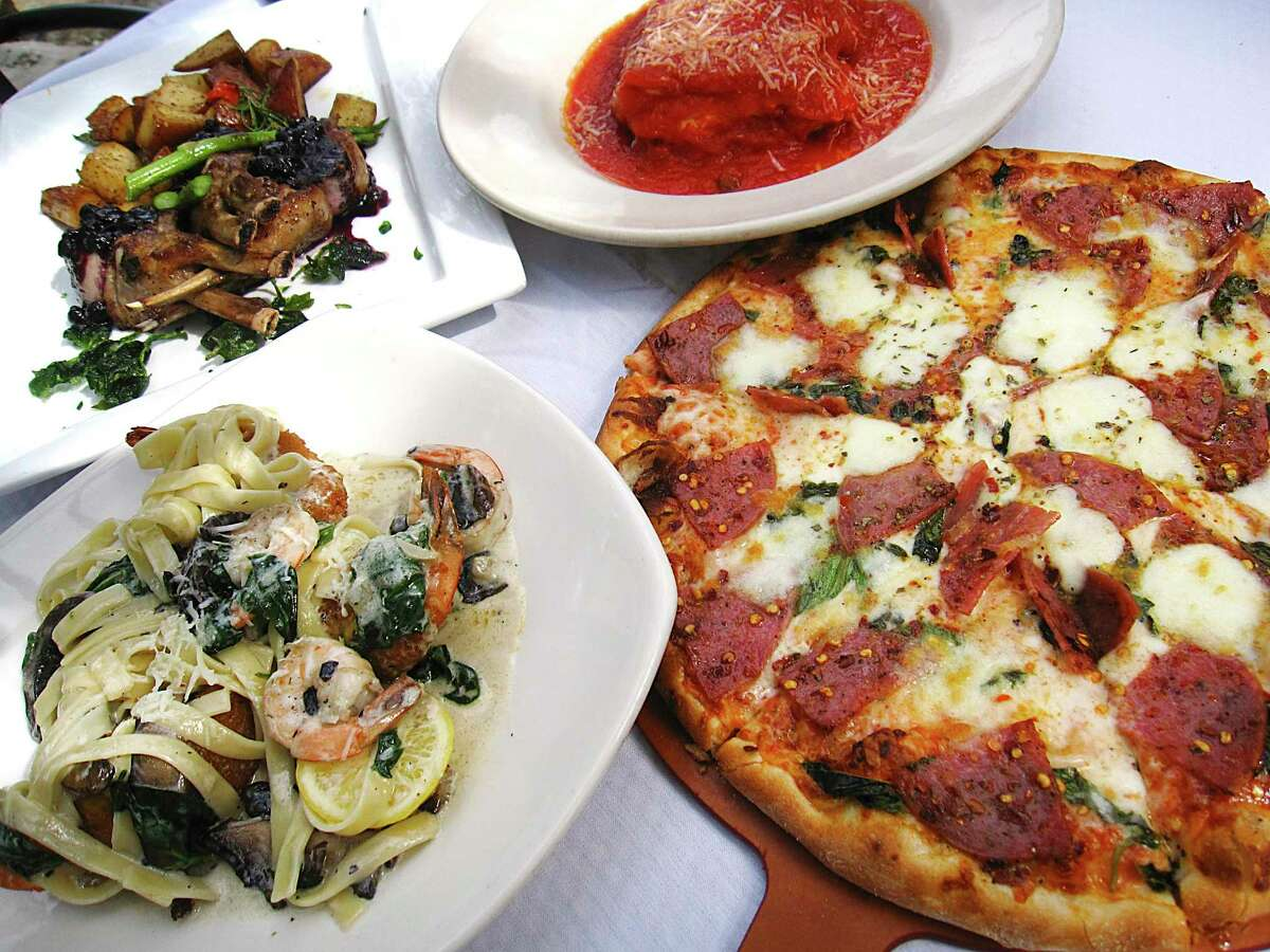 A full table order might include, clockwise from bottom left, Gamberi Portabella, rack of lamb, lasagna and a piccante pizza with salami, mozzarella and basil at Gennaro's Trattoria.