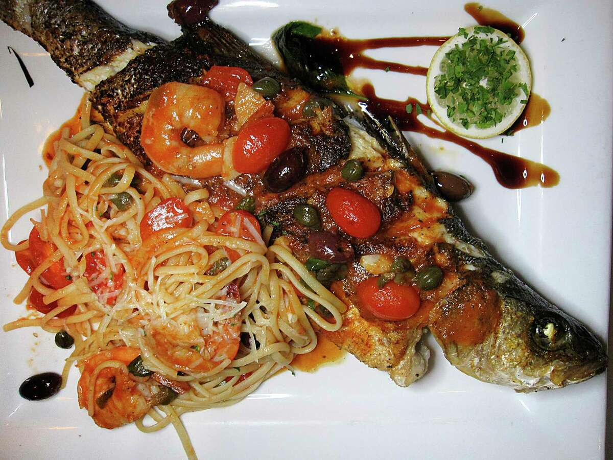 A whole grilled branzino is served with shrimp and pasta at Gennaro's Trattoria.