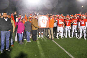 United High School players, coaches and administrators retire the jersey of United High School football player Jalen Garcia during halftime of the United versus Alexander football game, November, 7, 2019 at the United ISD SAC.