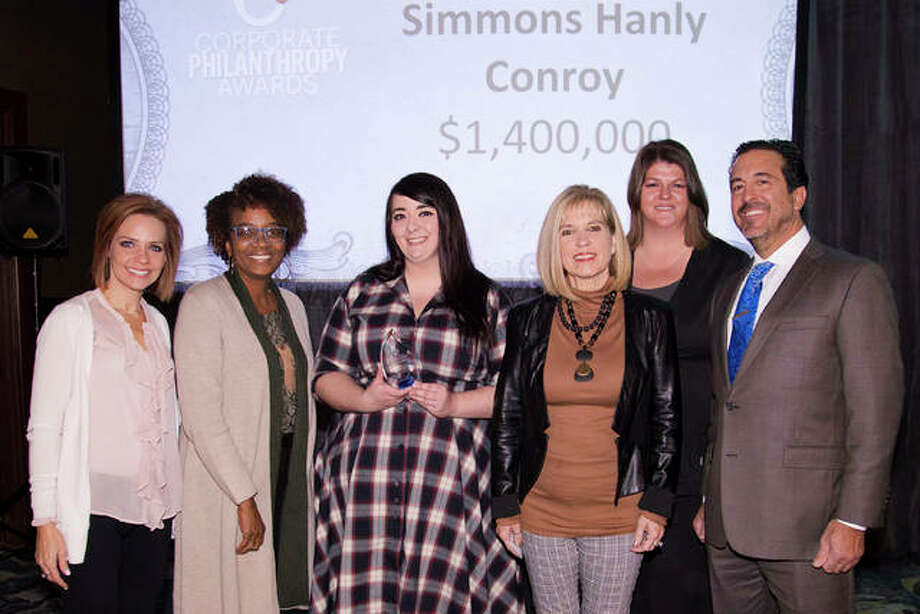 Several Simmons Hanly Conroy employees were present to accept the firm's recent Corporate Philanthropy Award from St. Louis Business Journal. From left are Tamara Jesse, Stephanie Elliott, Ashley Kuenstler, Medical Director Amy Fair, Assistant Managing Partner Amy Garrett and Shareholder Ted Gianaris.