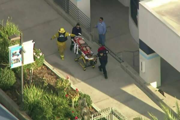 In this photo from video provided by KTLA-TV paramedics transport an injured person after a shooting at Saugus High School in Santa Clarita, Calif., early Thursday, Nov. 14, 2019.