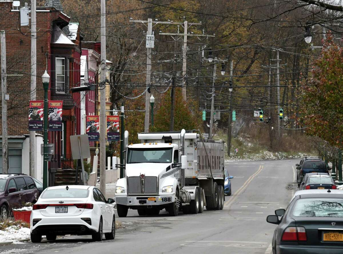 A tractor trailer heads up First Street on Thursday, Nov. 14, 2019, in Troy, N.Y. Troy's $10 million South Troy Industrial Road design aims to get tractor trailers off neighborhood streets and spur economic development. (Will Waldron/Times Union)