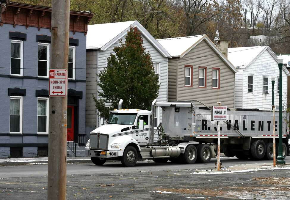 A tractor trailer heads up Second Street on Thursday, Nov. 14, 2019, in Troy, N.Y. Troy's $10 million South Troy Industrial Road design aims to get tractor trailers off neighborhood streets and spur economic development. (Will Waldron/Times Union)