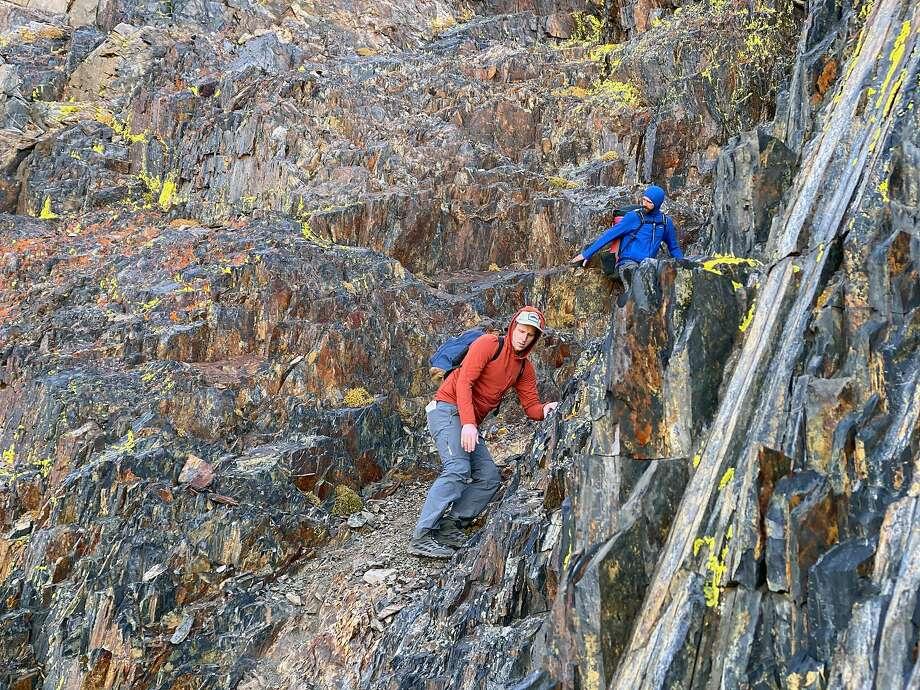 Chronicle editor Gregory Thomas (left) and BASE jumper Jordan Kilgore make their way down Mt. Morrison towards the BASE jump site. Photo: Daniel Ristow