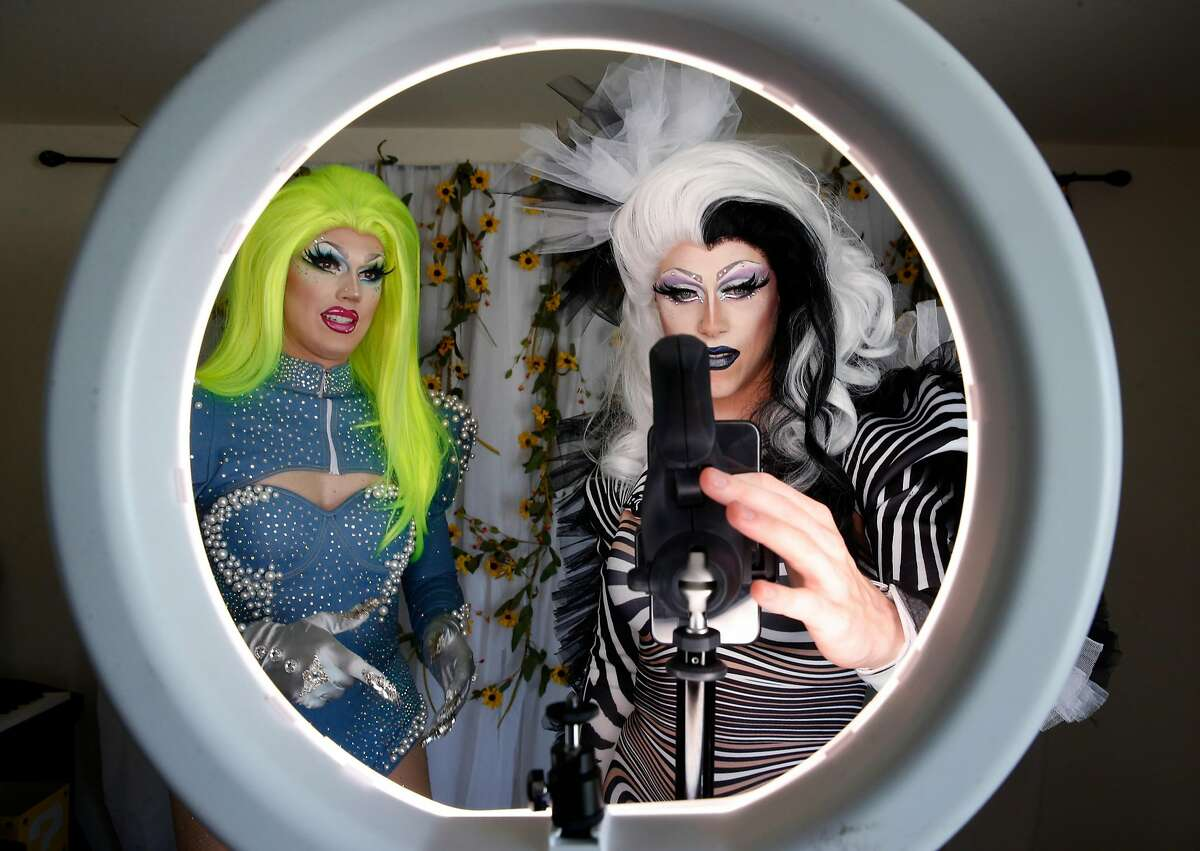 """Scott Artice (left) and his husband Zachary record a session for their popular """"Minnie and Tink"""" drag queen webcast created on the TikTok social media app in Daly City, Calif. on Saturday, Nov. 2, 2019."""