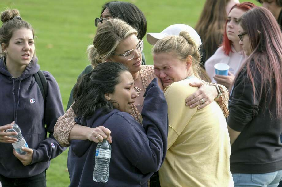 Students are comforted as they wait to be reunited with their parents following a shooting at Saugus High School that injured several people, Thursday, Nov. 14, 2019, in Santa Clarita, Calif. (AP Photo/Ringo H.W. Chiu) Photo: Ringo H.W. Chiu/AP