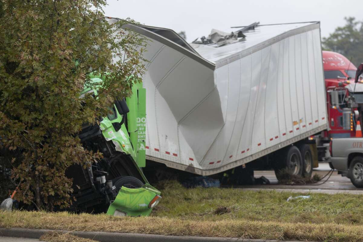 The front end of a wrecked 18-wheeler is seen Thursday, November 14, 2019 on Interstate 45 near Lake Woodlands Drive in The Woodlands. The truck slammed into the back of a stalled Greyhound bus early Thursday injuring several people.