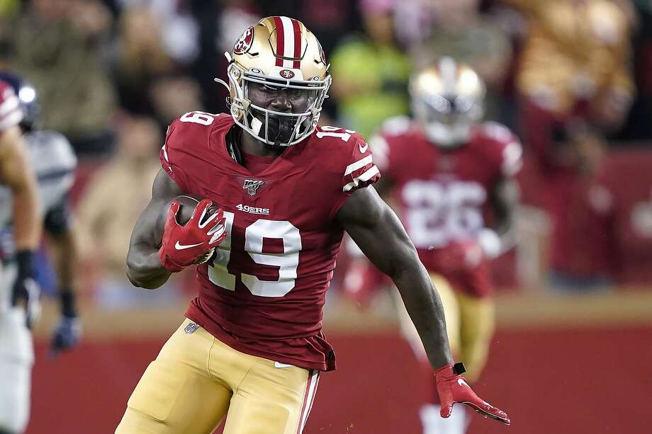 San Francisco 49ers wide receiver Deebo Samuel (19) runs against the Seattle Seahawks during the first half of an NFL football game in Santa Clara, Calif., Monday, Nov. 11, 2019. Photo: Tony Avelar / Associated Press