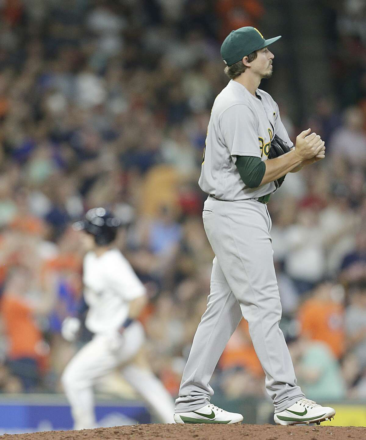Ryan Dull #66 of the Oakland Athletics reacts as Alex Bregman #2 of the Houston Astros circles the bases after hitting a home run in the eighth inning at Minute Maid Park on August 19, 2017 in Houston, Texas. (Photo by Thomas B. Shea/Getty Images)