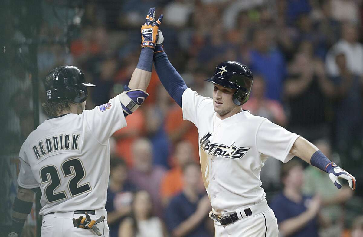 Josh Reddick #22 of the Houston Astros celebrates Alex Bregman #2 home run against rhin the eighth inning at Minute Maid Park on August 19, 2017 in Houston, Texas. (Photo by Thomas B. Shea/Getty Images)