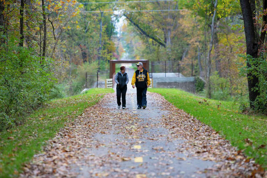 A pair of walkers travers the $10 million Troy-O'Fallon extension of the Madison County Transit Goshen Trail. An opening ceremony is set for 11 a.m. Saturday at MCT Park & Bike Lot on Kyle Road in O'Fallon, Illinois.